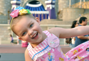 A young girl is filled with joy at Give Kids the World.